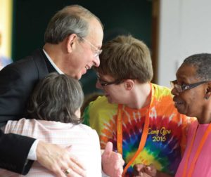 Archbishop Lori visits Camp GLOW participants.