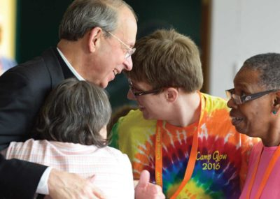 Archbishop Lori visits Camp GLOW participants.