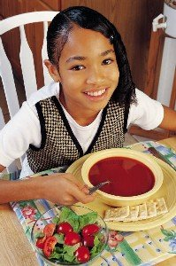 Photo: child eating soup