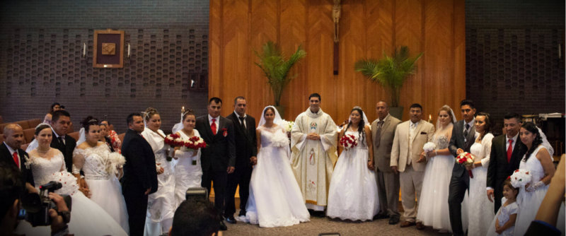 Catholic wedding in columbia unites 10 hispanic couples father leandro fazolini center associate pastor to the hispanic community at st john the evangelist in columbia officiated at the marriage of 10 junglespirit Images
