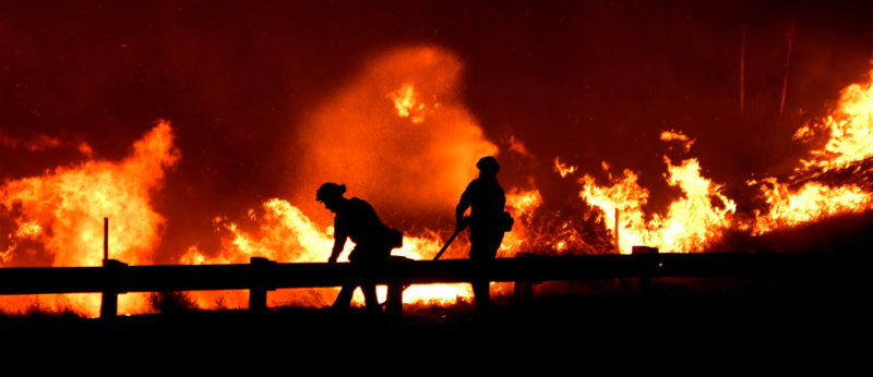 Firefighters battle a wind-driven wildfire Oct. 25, 2019, in Canyon Country near Los Angeles.