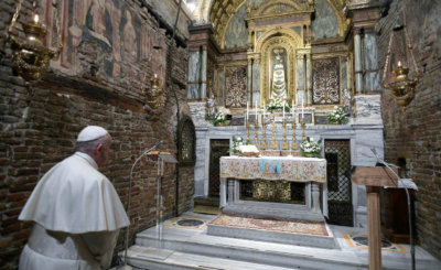 Pope Francis prays before a statue of Our Lady of Loreto at the Sanctuary of the Holy House on the feast of the Annunciation in Loreto, Italy, March 25, 2019.