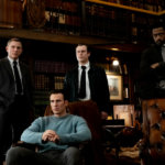 """Daniel Craig, Chris Evans, Noah Segan and LaKeith Stanfield star in a scene from the movie """"Knives Out."""" (CNS photo/Lionsgate)"""